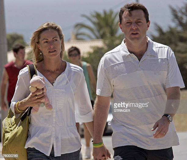 Gerry and Kate McCann parents of missing fouryearold Briton Madeleine McCann walk in Praia da Luz 07 August 2007 Portuguese and British newspapers...