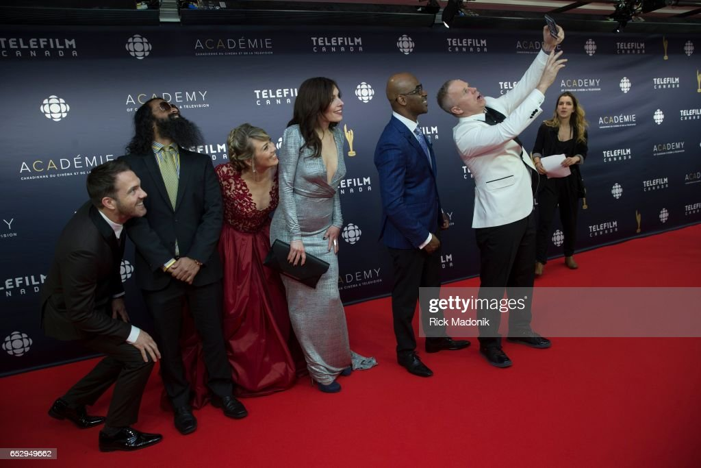 Gerry Dee snaps a selfie of himself and friends on the red carpet. Canadian Screen Awards red carpet at Sony Centre for the Performing Arts ahead of the show.