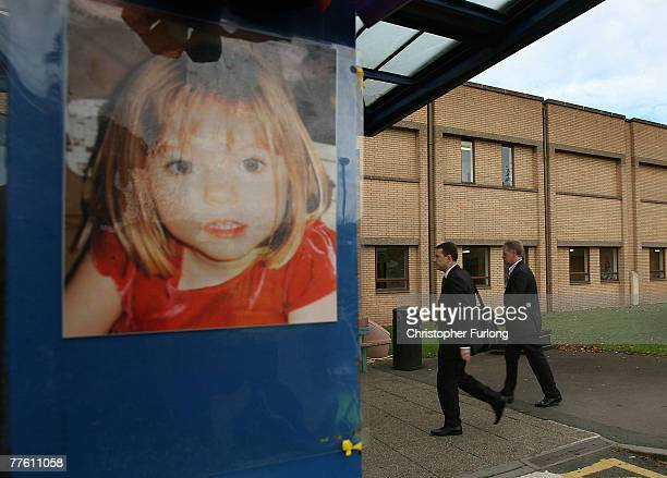 Gerry McCann escorted by his advisor Clarence Mitchell walks past a poster of his missing daughter as he returns for work at Glenfield Hospital where...