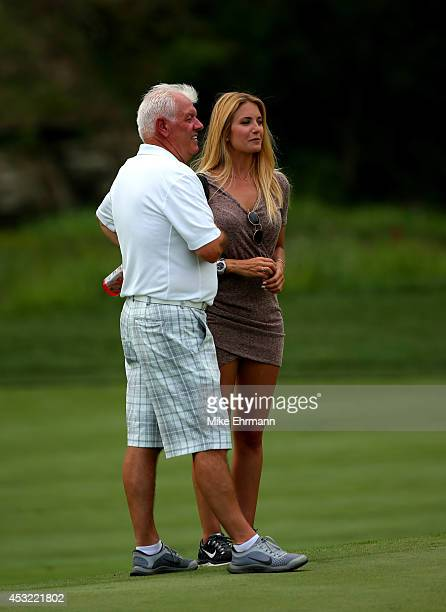 Gerry McIlory father of Rory McIlroy talks Gala Alten girlfriend of Pablo Larrazabal during a practice round prior to the start of the 96th PGA...