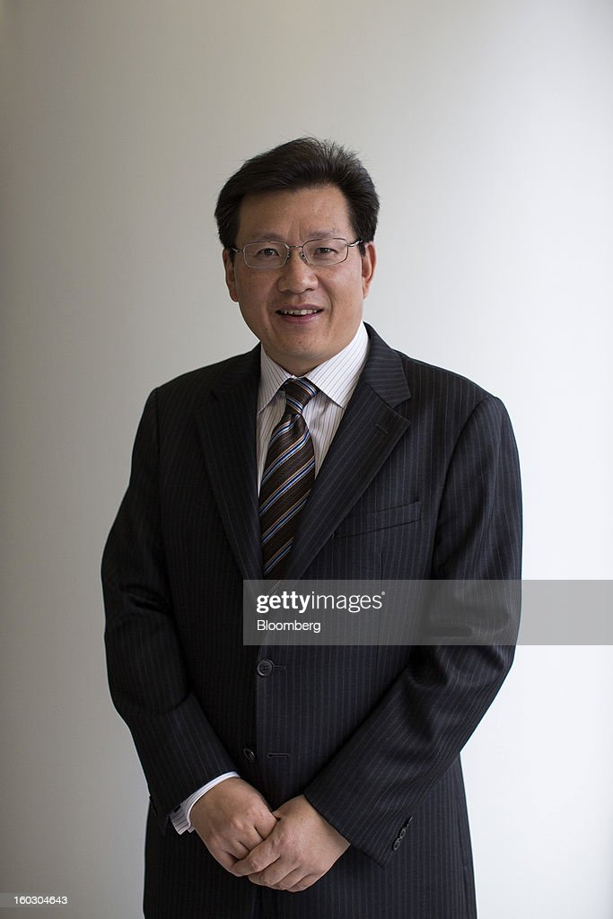 Gerry Wang, chief executive officer of Seaspan Corp., poses for a photograph in Hong Kong, China, on Tuesday, Jan. 29, 2013. Seaspan is likely to order another ten to 15 ships within a year, Wang said. Photographer: Jerome Favre/Bloomberg via Getty Images