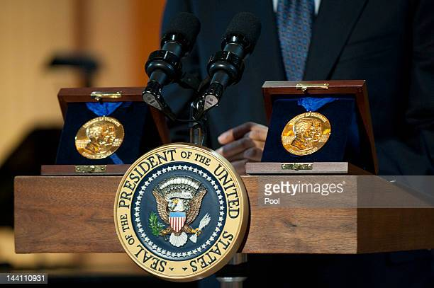 Gershwin Prizes are seen on the podium as President Barack Obama delivers remarks at a concert honoring award winners Burt Bacharach and Hal David in...