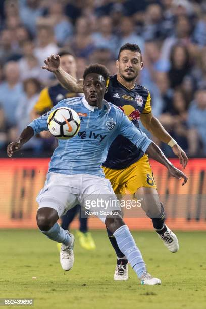 Gerso of Sporting Kansas City holds off Felipe Martins of New York Red Bulls in the US Open Cup Final match at Children's Mercy Park on September 20...