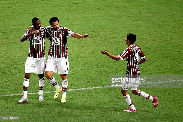Gerson and Fred of Fluminense celebrate with Gustavo Scarpa ater his goal against Goias during a match between Fluminense and Goias as part of...