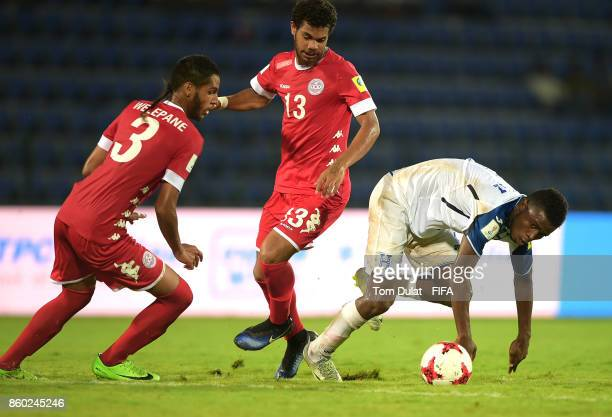 Gerson Chavez of Honduras battles for the ball with Josue Welepane and Vita Longue of New Caledonia during the FIFA U17 World Cup India 2017 group E...