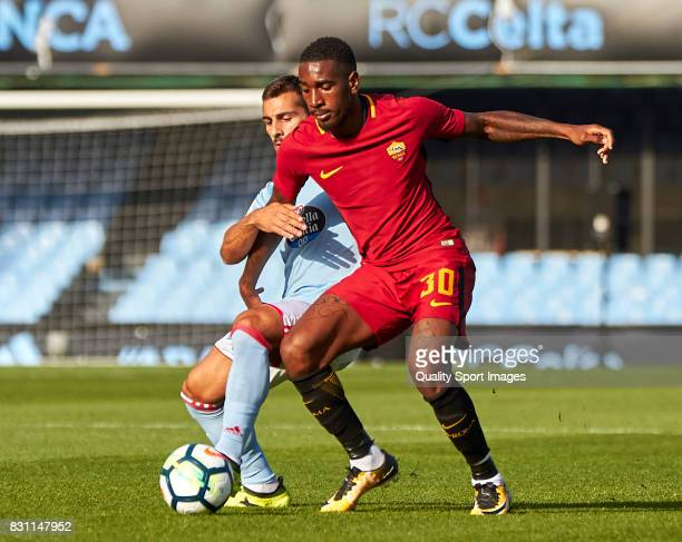 Gerson Santos Da Silva of AS Roma competes for the ball with Jonny Castro of Celta de Vigo during the preseason friendly match between Celta de Vigo...