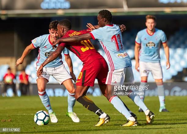 Gerson Santos Da Silva of AS Roma competes for the ball with Pione Sisto of Celta de Vigo during the preseason friendly match between Celta de Vigo...
