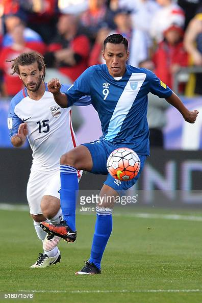 Gerson Tinoco of Guatemala gains control of the ball in front of Kyle Beckerman of the United States Men's National Team in the first half during the...
