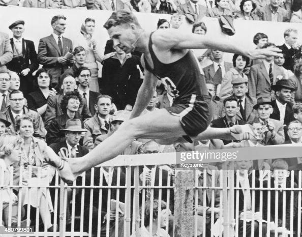 Gert Potgieter of South Africa takes the final hurdle to win the 440 yards hurdles in a world record time of 4973 seconds at the British Empire and...