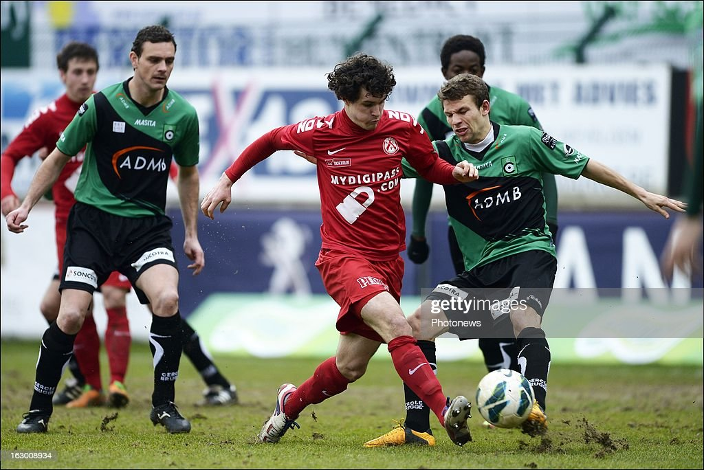Gertjan Demets of KV Kortrijk is stopped by Van Eenoo Lukas of Cercle Brugge during the Cofidis Cup semi-final match between KV Kortrijk and Cercle Brugge in the Guldensporen stadium on March 03, 2013 in Kortrijk, Belgium.