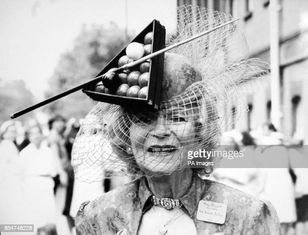 Gertrude Shilling mother of milliner DAvid Shilling on the ball at Royal Ascot's Ladies Day in a red creation teamed with matching millinery trimmed...