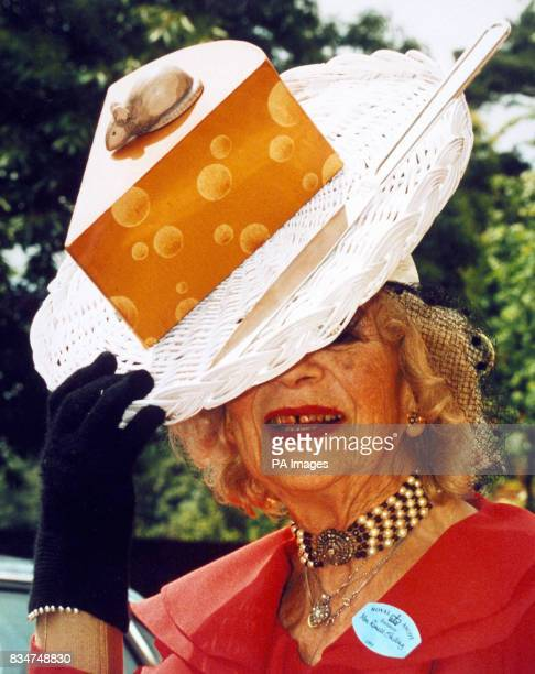 Gertrude Shilling wears one of her son's David Shilling's creations a hat with cheese a mouse and a knife