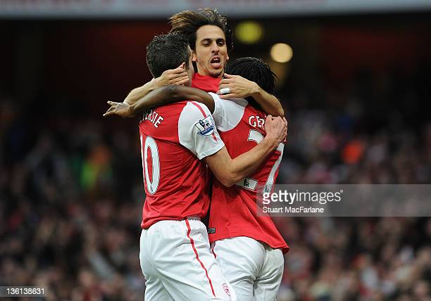 Gervinho celebrates scoring the Arsenal goal with Yossi Benayoun and Robin van Persie during the Barclays Premier League match between Arsenal and...