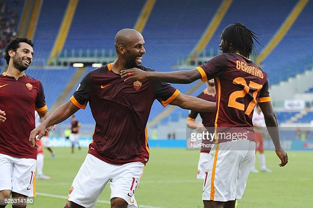 Gervinho celebrates with Maicon after he scored his team third goal during the Italian Serie A match between AS Roma and FC Carpi at Stadio Olimpico...
