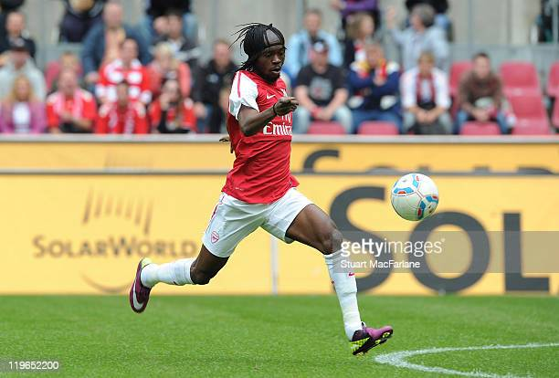 Gervinho of Arsenal breaks through to score Arsenal's first goal during the pre season friendly match between Cologne and Arsenal at...