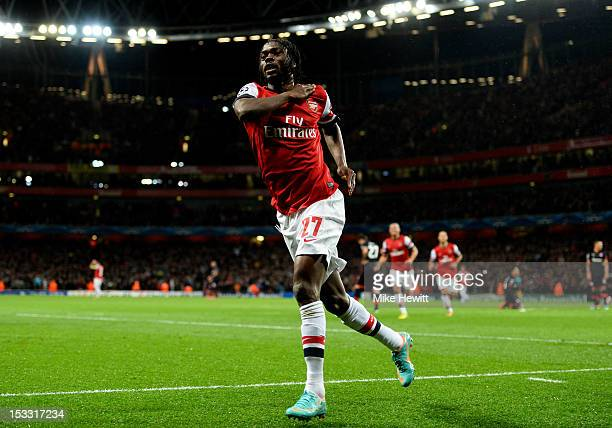 Gervinho of Arsenal celebrates after scoring the opening goal during the UEFA Champions League Group B match between Arsenal FC and Olympiacos FC at...