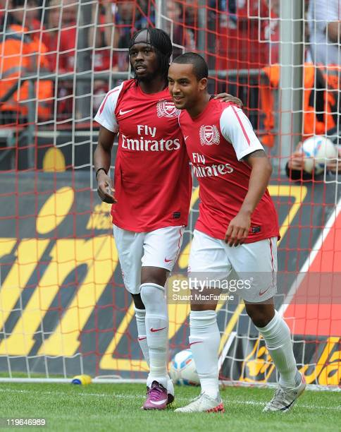 Gervinho of Arsenal celebrates after scoring the second goal for Arsenal with teammateTheo Walcott during the pre season friendly match between...