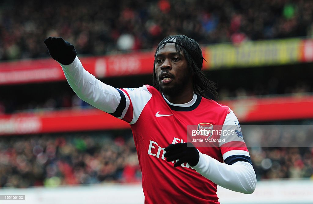 <a gi-track='captionPersonalityLinkClicked' href=/galleries/search?phrase=Gervinho&family=editorial&specificpeople=4500752 ng-click='$event.stopPropagation()'>Gervinho</a> of Arsenal celebrates as he scores their first goal during the Barclays Premier League match between Arsenal and Reading at Emirates Stadium on March 30, 2013 in London, England.