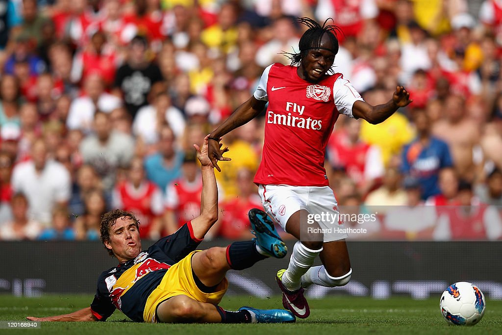 Gervinho of Arsenal is tackled by Chris Albright of New York Red Bulls during the Emirates Cup match between Arsenal and New York Red Bulls at the Emirates Stadium on July 31, 2011 in London, England.