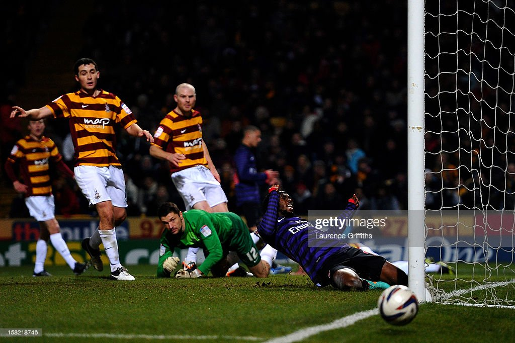 Gervinho of Arsenal reacts after missing a chance on goal during the Capital One Cup quarter final match between Bradford City and Arsenal at the Coral Windows Stadium, Valley Parade on December 11, 2012 in Bradford, England.