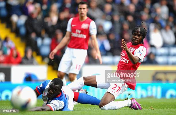Gervinho of Arsenal scores the opening goal under pressure from Chris Samba of Blackburn during the Barclays Premier League match between Blackburn...