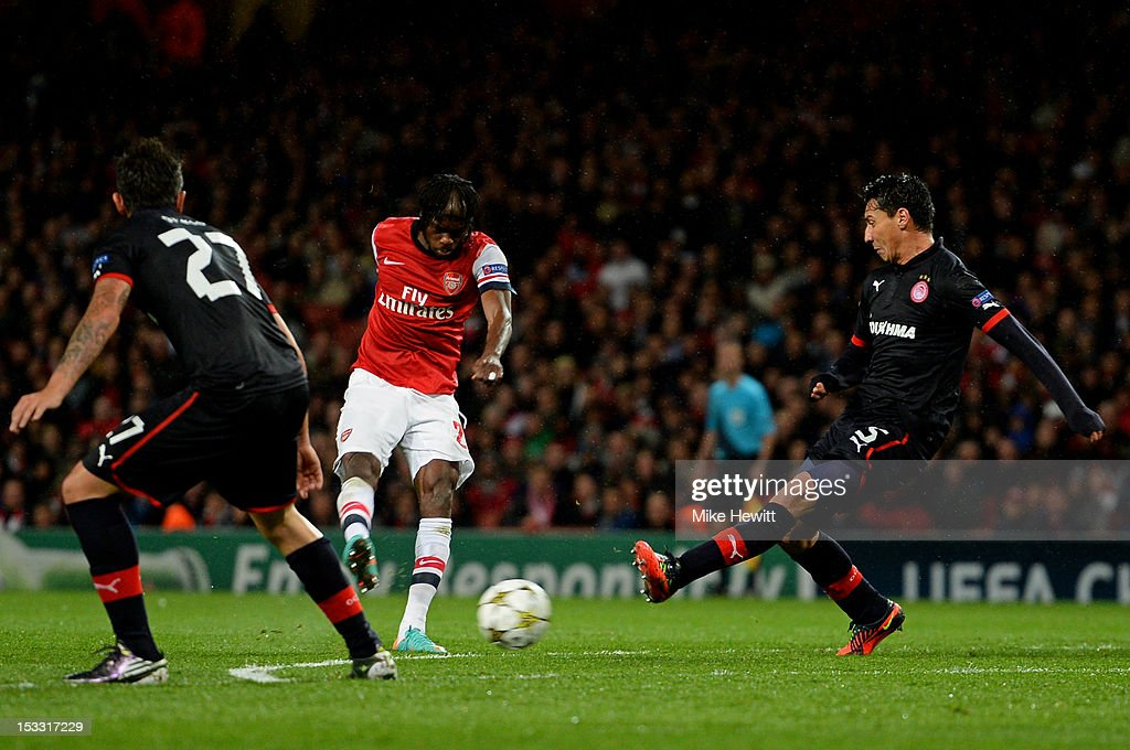 <a gi-track='captionPersonalityLinkClicked' href=/galleries/search?phrase=Gervinho&family=editorial&specificpeople=4500752 ng-click='$event.stopPropagation()'>Gervinho</a> of Arsenal shoots past <a gi-track='captionPersonalityLinkClicked' href=/galleries/search?phrase=Pablo+Contreras&family=editorial&specificpeople=662772 ng-click='$event.stopPropagation()'>Pablo Contreras</a> #15 of Olympiacos to sxcore the opening goal during the UEFA Champions League Group B match between Arsenal FC and Olympiacos FC at Emirates Stadium on October 03, 2012 in London, England.