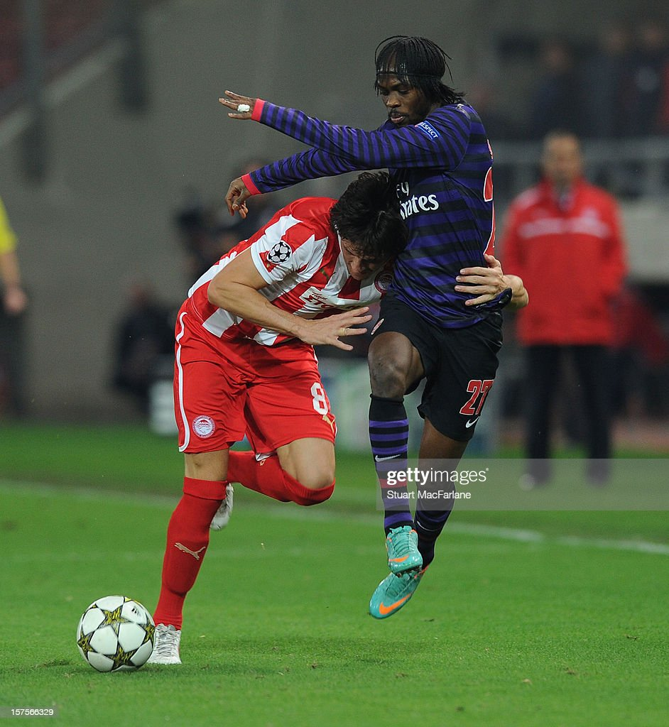 <a gi-track='captionPersonalityLinkClicked' href=/galleries/search?phrase=Gervinho&family=editorial&specificpeople=4500752 ng-click='$event.stopPropagation()'>Gervinho</a> of Arsenal takes on Ljubomir Fejsa of Olympiacos during the UEFA Champions League Group B match between Olympiacos FC and Arsenal FC at Georgios Karaiskakis Stadium on December 04, 2012 in Athens, Greece.