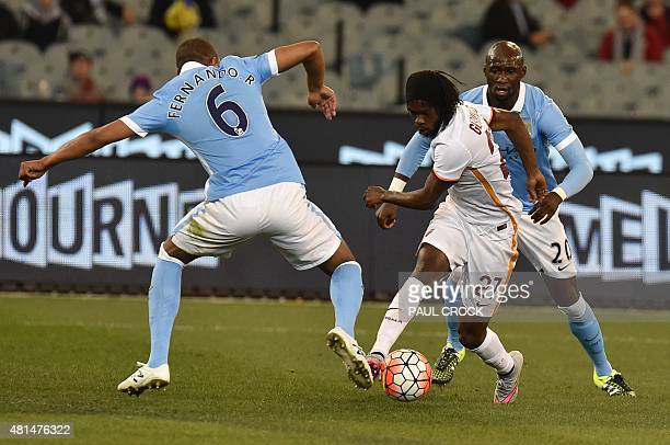 Gervinho of AS Roma challenges Manchester City's Fernando Francisco Reges and Eliaquim Mangala during the International Champions Cup football match...