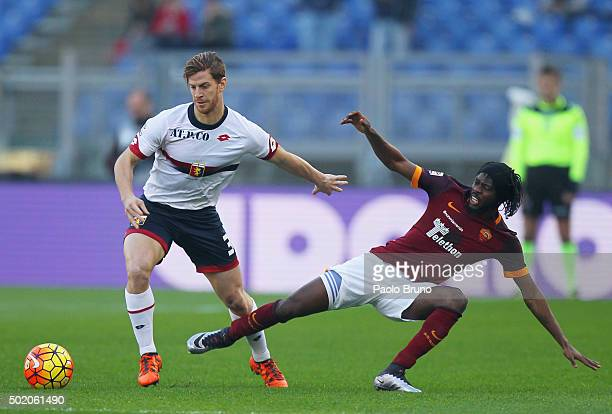 Gervinho of AS Roma competes for the ball with Cristian Ansaldi of Genoa CFC during the Serie A match between AS Roma and Genoa CFC at Stadio...