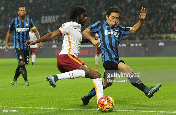 Gervinho of AS Roma competes for the ball with Yuto Nagatomo of FC Internazionale Milano during the Serie A match between FC Internazionale Milano...
