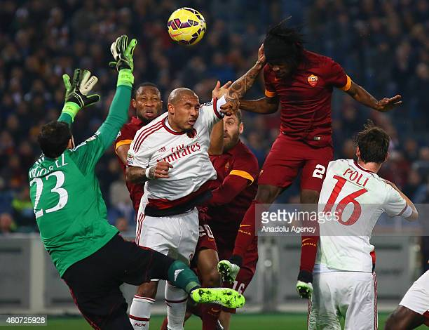 Gervinho of AS Roma vies for the ball with Andrea Poli Nigel de Jong and Diego Lopez of AC Milan during the Serie A match between AS Roma and AC...