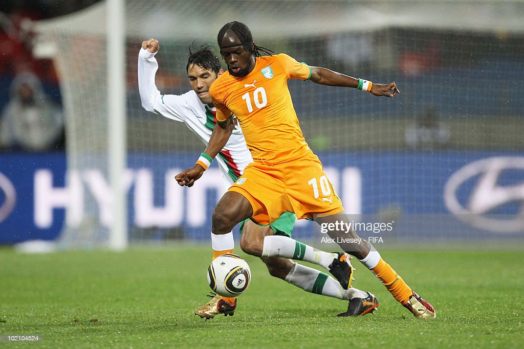 <a gi-track='captionPersonalityLinkClicked' href=/galleries/search?phrase=Gervinho&family=editorial&specificpeople=4500752 ng-click='$event.stopPropagation()'>Gervinho</a> of Ivory Coast and <a gi-track='captionPersonalityLinkClicked' href=/galleries/search?phrase=Paulo+Ferreira+-+Soccer+Player&family=editorial&specificpeople=185237 ng-click='$event.stopPropagation()'>Paulo Ferreira</a> of Portugal during the 2010 FIFA World Cup South Africa Group G match between Ivory Coast and Portugal at Nelson Mandela Bay Stadium on June 15, 2010 in Port Elizabeth, South Africa.