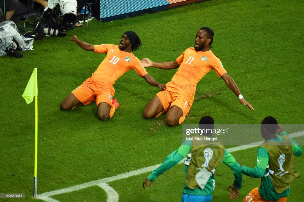 <a gi-track='captionPersonalityLinkClicked' href=/galleries/search?phrase=Gervinho&family=editorial&specificpeople=4500752 ng-click='$event.stopPropagation()'>Gervinho</a> of the Ivory Coast (L) celebrates scoring his team's second goal with teammate <a gi-track='captionPersonalityLinkClicked' href=/galleries/search?phrase=Didier+Drogba&family=editorial&specificpeople=179398 ng-click='$event.stopPropagation()'>Didier Drogba</a> during the 2014 FIFA World Cup Brazil Group C match between the Ivory Coast and Japan at Arena Pernambuco on June 14, 2014 in Recife, Brazil.