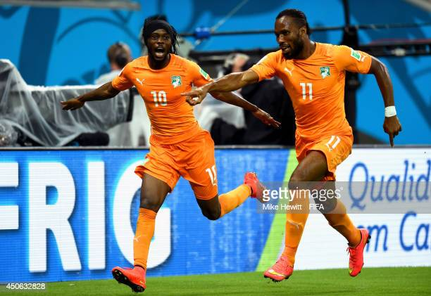 Gervinho of the Ivory Coast celebrates with Didier Drogba of the Ivory Coast after scoring the team's second goal during the 2014 FIFA World Cup...