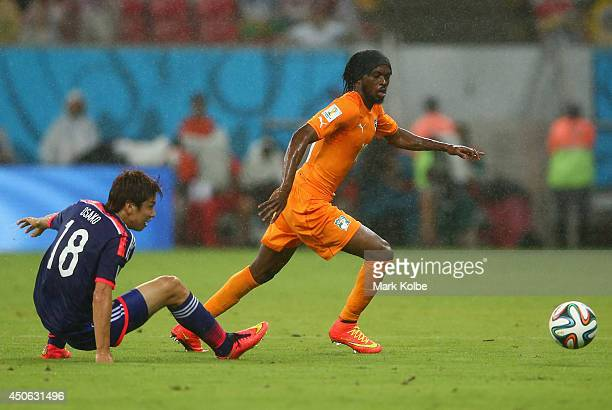 Gervinho of the Ivory Coast controls the ball against Yuya Osako of Japan during the 2014 FIFA World Cup Brazil Group C match between the Ivory Coast...