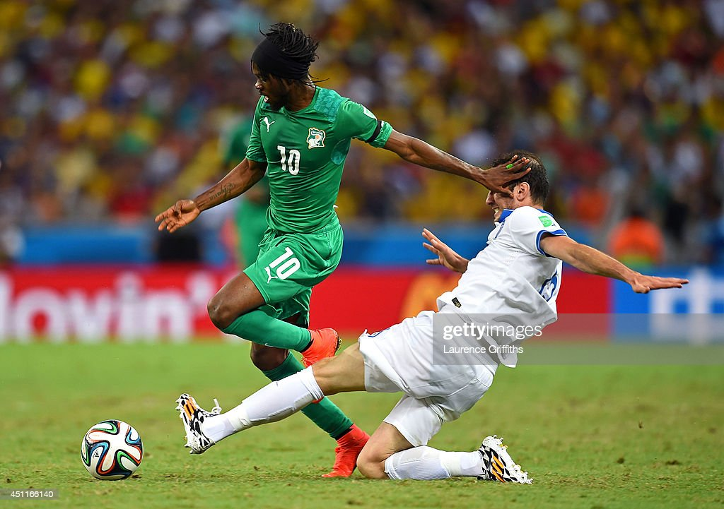 <a gi-track='captionPersonalityLinkClicked' href=/galleries/search?phrase=Gervinho&family=editorial&specificpeople=4500752 ng-click='$event.stopPropagation()'>Gervinho</a> of the Ivory Coast is tackled by <a gi-track='captionPersonalityLinkClicked' href=/galleries/search?phrase=Vasilis+Torosidis&family=editorial&specificpeople=4542702 ng-click='$event.stopPropagation()'>Vasilis Torosidis</a> of Greece during the 2014 FIFA World Cup Brazil Group C match between Greece and the Ivory Coast at Castelao on June 24, 2014 in Fortaleza, Brazil.