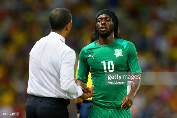 Gervinho of the Ivory Coast shakes hands with head coach Sabri Lamouchi during the 2014 FIFA World Cup Brazil Group C match between Greece and Cote...
