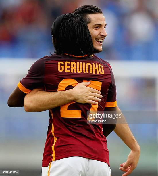 Gervinho with his teammate Kostas Manolas of AS Roma celebrates after scoring the team's third goal during the Serie A match between AS Roma and...