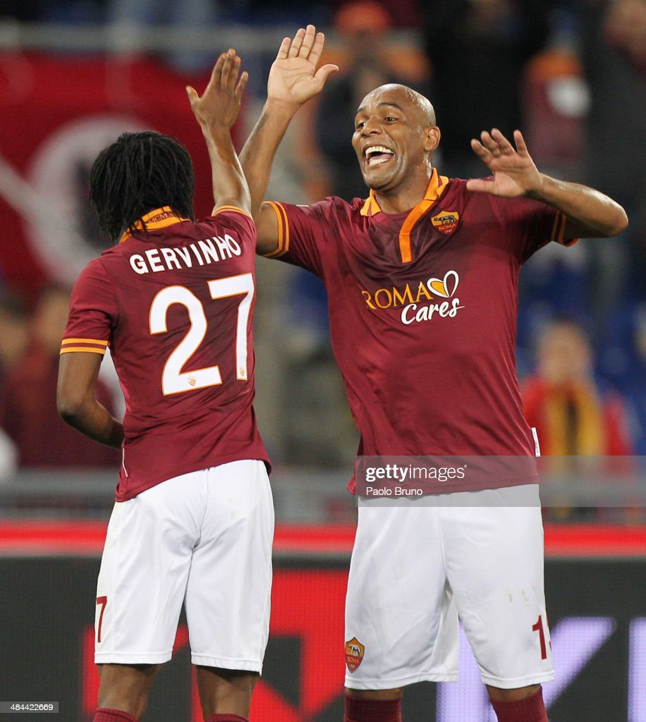 <a gi-track='captionPersonalityLinkClicked' href=/galleries/search?phrase=Gervinho&family=editorial&specificpeople=4500752 ng-click='$event.stopPropagation()'>Gervinho</a> (L) with his teammate <a gi-track='captionPersonalityLinkClicked' href=/galleries/search?phrase=Maicon+-+Brazil+National+Soccer+Team+and+A.S.+Roma&family=editorial&specificpeople=2639404 ng-click='$event.stopPropagation()'>Maicon</a> of AS Roma celebrates after scoring the third team's goal during the Serie A match between AS Roma and Atalanta BC at Stadio Olimpico on April 12, 2014 in Rome, Italy.