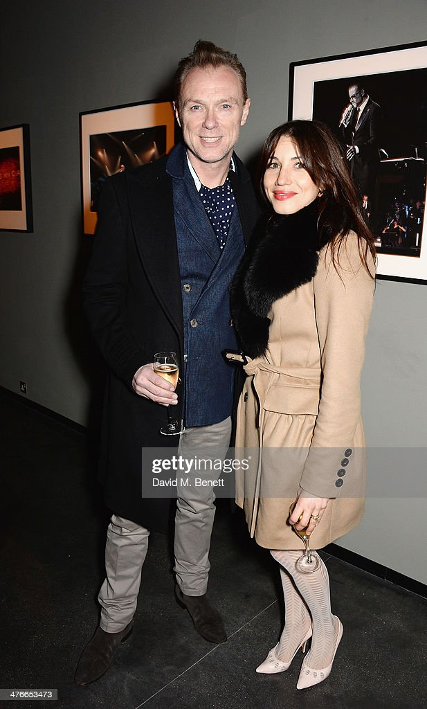 Gery Kemp and Lauren Barber attend 'Symphonica' - George Michael Album Launch Party at Hamiltons Gallery on March 4, 2014 in London, England.