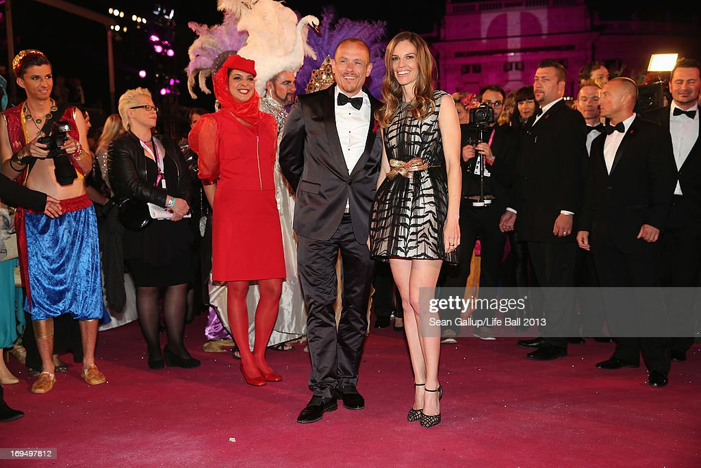 Gery Keszler and Hilary Swank attend the 'Life Ball 2013 - Magenta Carpet Arrivals' at City Hall on May 25, 2013 in Vienna, Austria.
