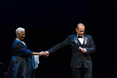 Gery Keszler greets Dionne Warwick on stage during the Red Ribbon Celebration Concert at Burgtheater on June 10 2016 in Vienna Austria The Red Ribbon...