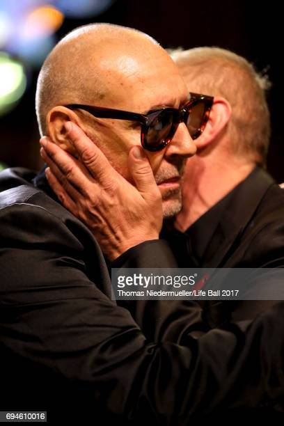 Gery Keszler kisses Michel Comte at the Life Ball 2017 Gala Dinner at City Hall on June 10 2017 in Vienna Austria