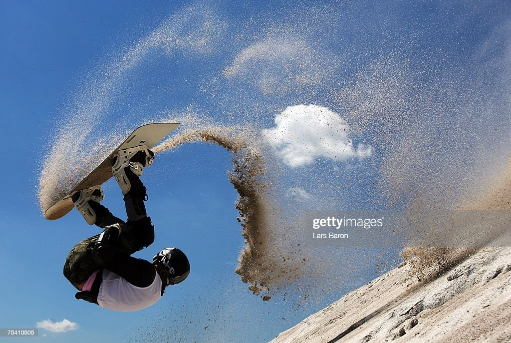 Gesine Sahlfeld of Germany jumps a frontflip during the Sandslopestyle competition at the Sandboarding World Championship 2007 at the Monte Kaolino on July 14, 2007 in Hirschau, Germany.
