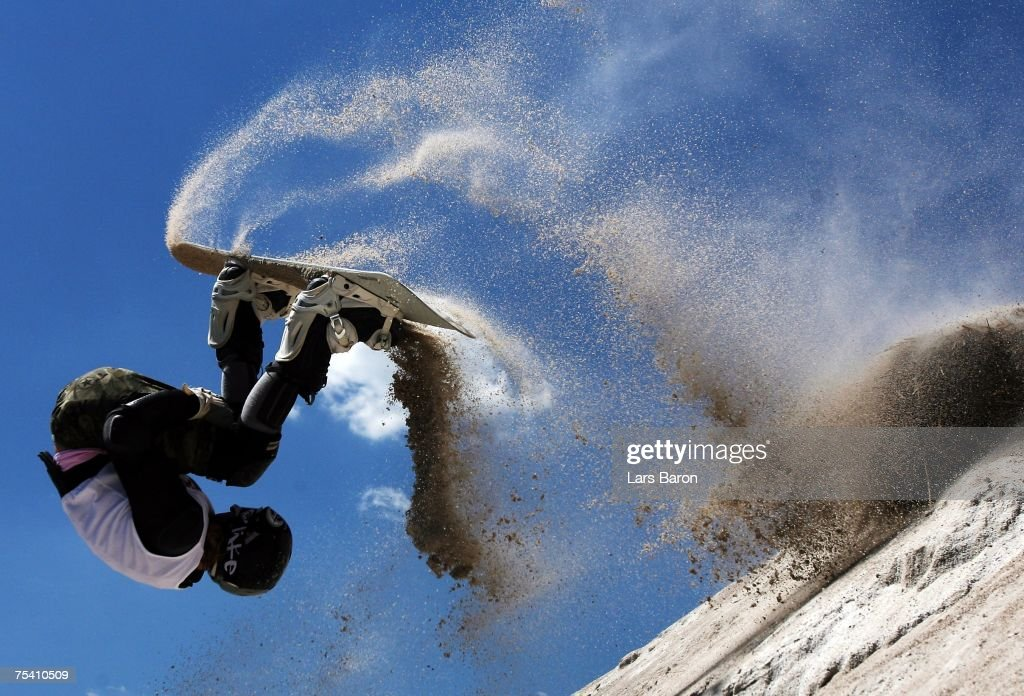 Gesine Sahlfeld of Germany jumps a frontflip from a kicker during the Sandslopestyle competition at the Sandboarding World Championship 2007 at the Monte Kaolino on July 14, 2007 in Hirschau, Germany.