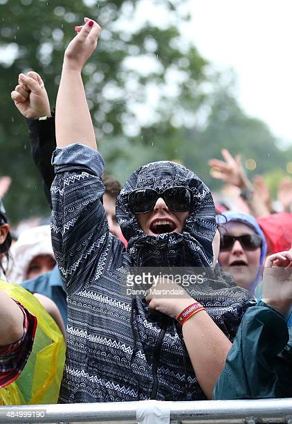A gestival goer dances in the rain to Ella Eyre on Day 2 of the V Festival at Hylands Park on August 23 2015 in Chelmsford England
