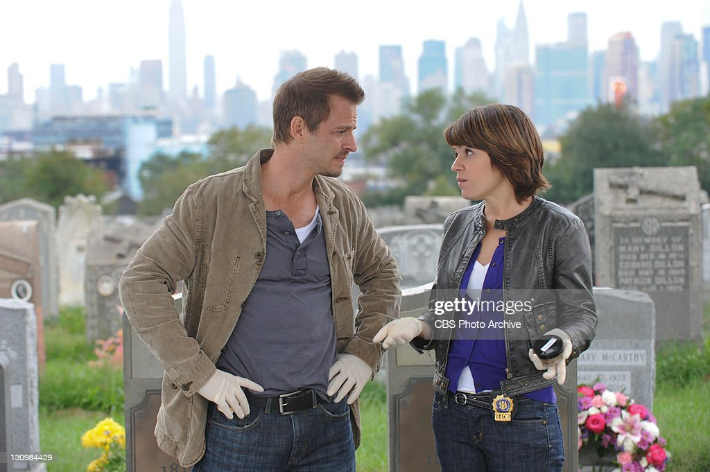 'Get Me Out Of Here' -- Danny Messer (Carmine Giovinazzo, left) and Lindsay Monroe Messer (Anna Belknap) investigate when a fraternity prank goes awry, and a pledge master is left for dead in an open grave on