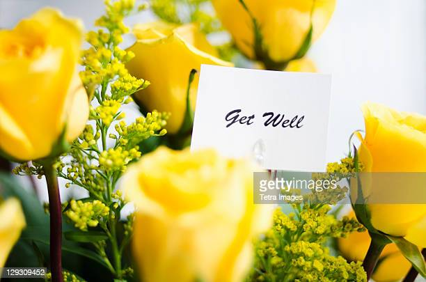 Get well card on bouquet of roses