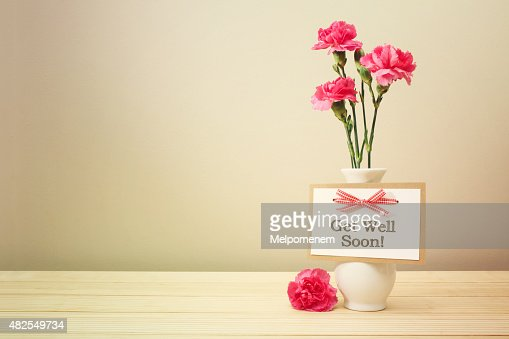 Get Well Soon Message With Pink Carnations Stock Photo  Thinkstock