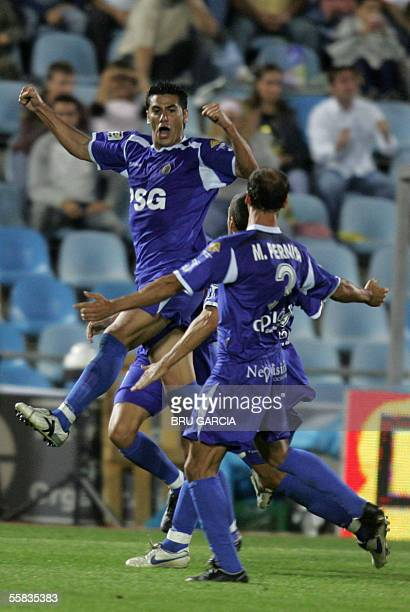 Getafes Riki celebrates his goal against Valencia during their Spanish League football match at the Alfonso Perez Coliseum in Getafe near Madrid 01...